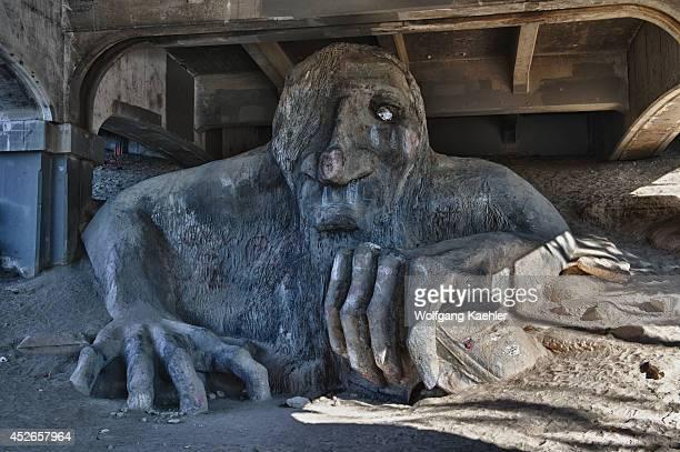 Hdr photo of the Fremont Troll under the Aurora Bridge in Seattles Fremont neighborhood Washington State USA
