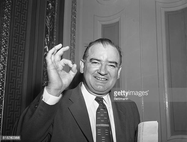 He Approves. Washington, D.C.: Sen. Joseph R. McCarthy Wisconsin, gives a sign of hearty approval after Senator John McClellan Ark., announced...