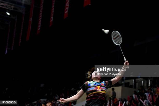 He BingJiao of China competes against Carolina Marin of Spain during the Women's Singles Quarter Final match of the Daihatsu Indonesia Masters 2018...