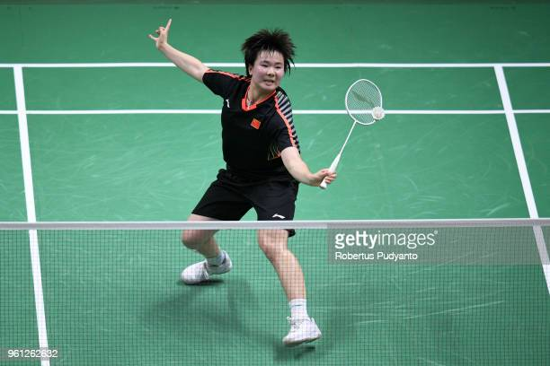 He Bingjiao of China competes against Goh Jin Wei of Malaysia during Preliminary Round on day three of the BWF Thomas Uber Cup at Impact Arena on May...
