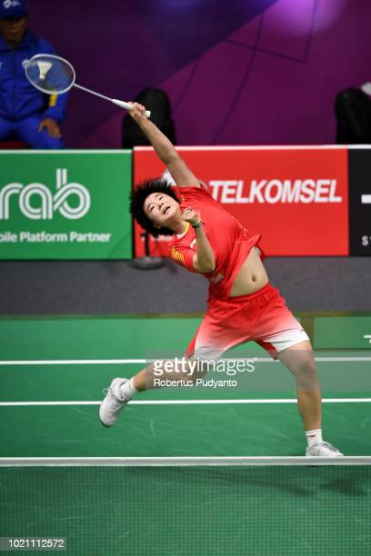 He Bingjiao of China competes against Nozomi Okuhara of Japan during Women's Team final match between Japan and China on day four of the Asian Games...