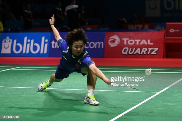 He Bingjiao of China competes against Pusarla V Sindhu of India during the Women's Singles Quarterfinal match on day four of the Blibli Indonesia...