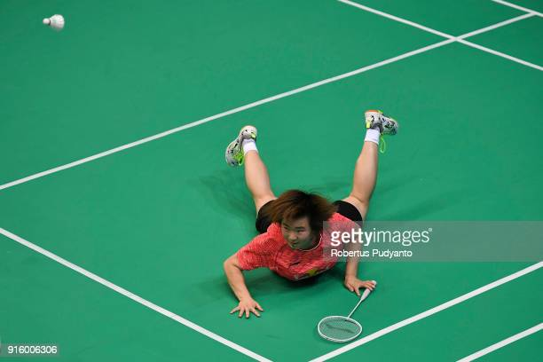 He Bingjiao of China falls as she competes against Pornpawee Chochuwong of Thailand during Women's Team Quarterfinal match of the EPlus Badminton...