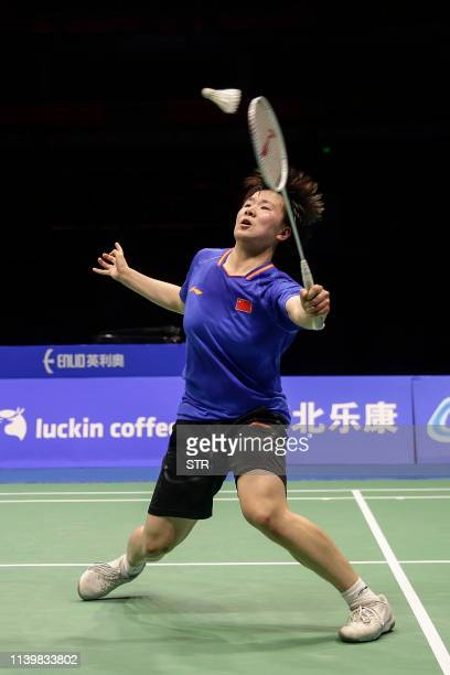 He Bingjiao of China hits a return against Akane Yamaguchi of Japan during the women's singles final at the 2019 Badminton Asia Championships in...