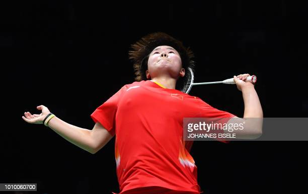 TOPSHOT He Bingjiao of China hits a shot against Tai Tzu Ying of Taiwan in their woman's singles match during the badminton World Championships in...