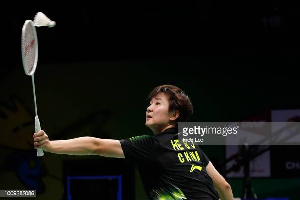 He Bingjiao of China hits a shot against Thuy Linh Nguyen of Vietnam in their Women's singles match during the Badminton World Championships at...