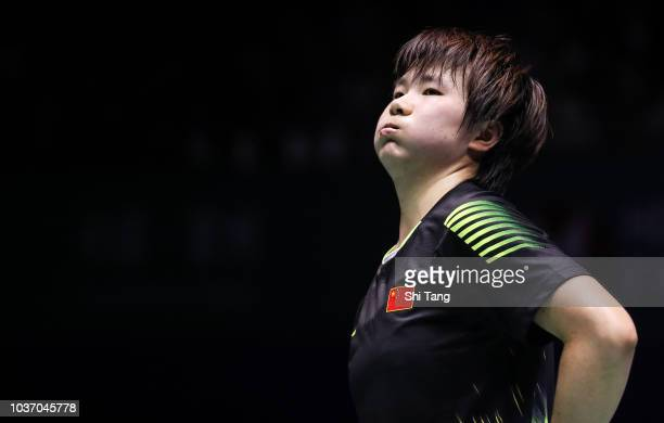 He Bingjiao of China reacts after a point in the Women's Singles quarter finals match against Akane Yamaguchi of Japan on day four of the China Open...