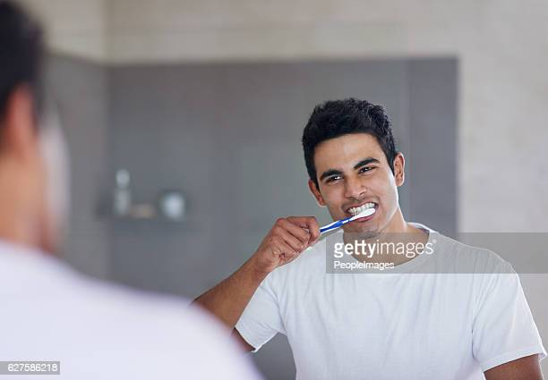 He brushes twice daily for optimal oral health