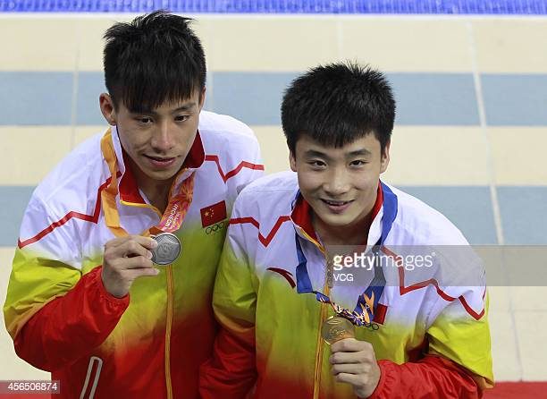 He Chao and Cao Yuan of China win the gold and silver medals in men's single 3 m springboard during day thirteen of the 2014 Asian Games at Munhak...