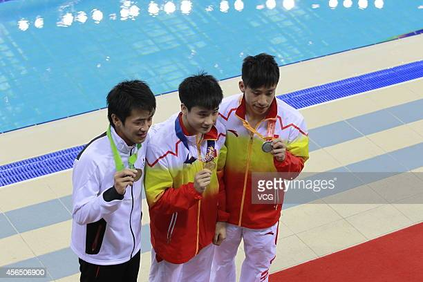 He Chao and Cao Yuan of China wins gold and silver medal in men's single 3 m springboard during day thirteen of the 2014 Asian Games at Munhak Park...