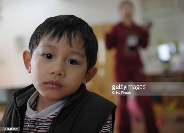 He Chengming 7i a disabled Chinese orphan adopted by American couple Douglas Hostetler and Amanda Hostetler sits at the SMIC Private School Wuhan on...