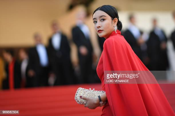 He Chengxi a lookalike of Chinese actress Fan Bingbing arrives on May 17 2018 for the screening of the film Capharnaum at the 71st edition of the...