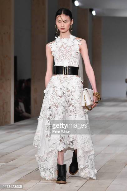 He Cong walks the runway during the Alexander McQueen Womenswear Spring/Summer 2020 show as part of Paris Fashion Week on September 30, 2019 in...