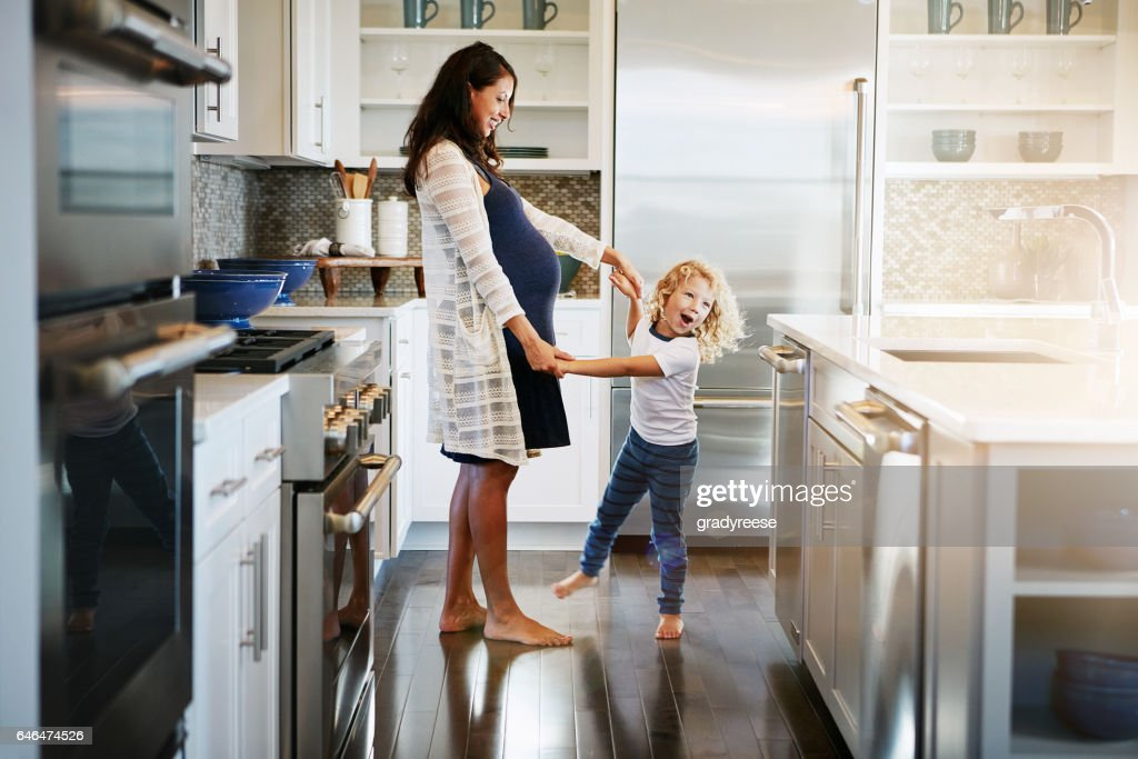 He could teach Mom a few moves : Stock Photo