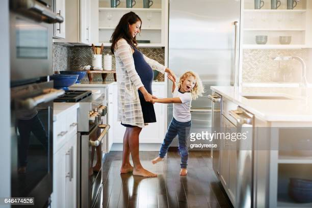 he could teach mom a few moves - family home stock photos and pictures