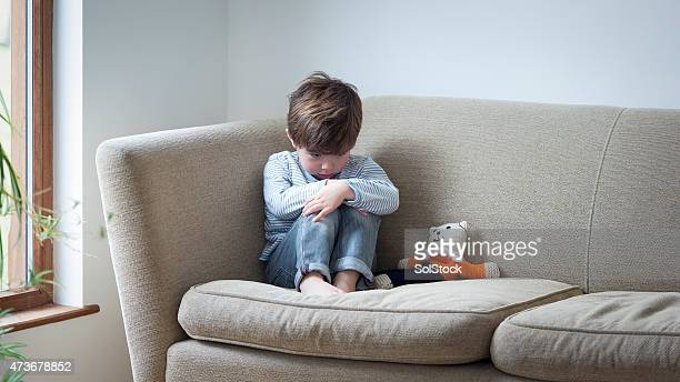he doesn't feel safe in his own home - boys stock pictures, royalty-free photos & images