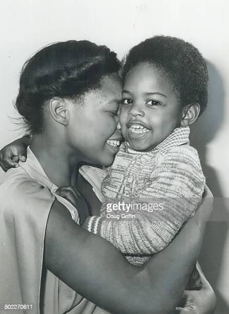 He drank cider Lawrence Liverpool 2 1/2 happily hugs his mother Hazel after being released from the Hospital for Sick Children where he was treated...