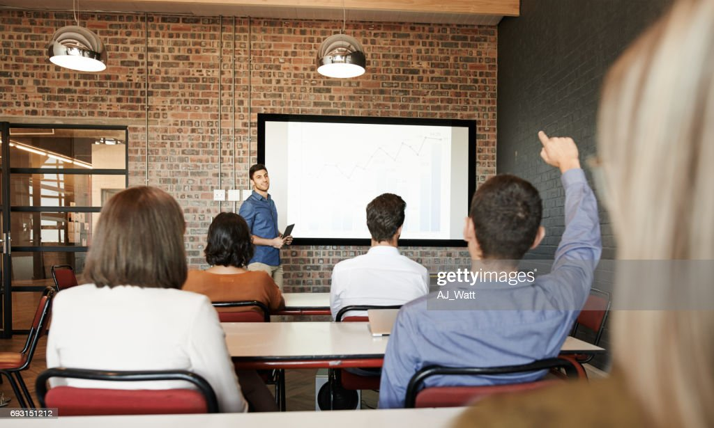 He encourages questions and answers in his presentations : Stock Photo
