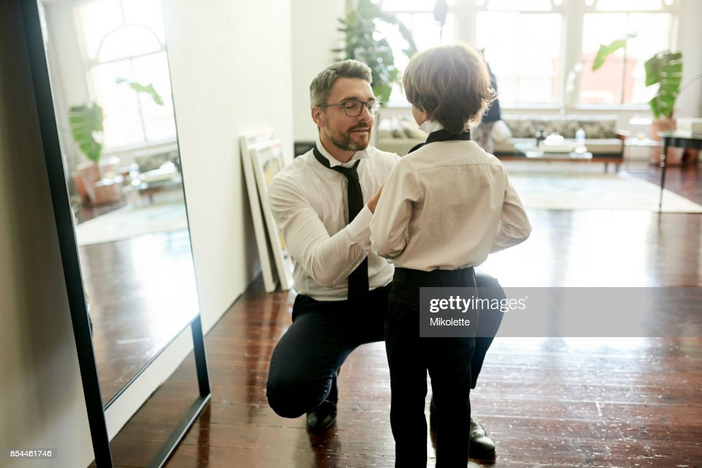 He gets his style from dad : Stock Photo