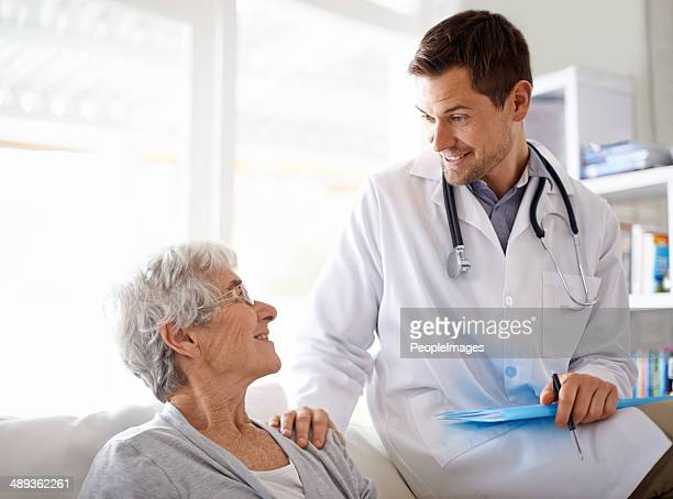 he has a great bedside manner with the seniors - house call stock photos and pictures