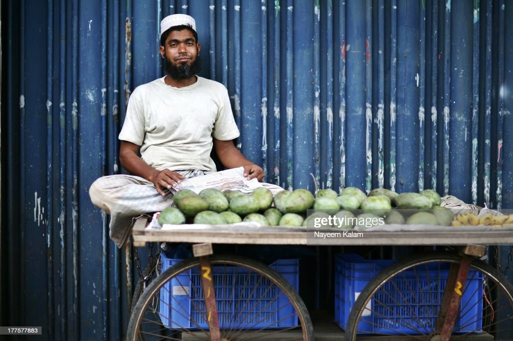 CONTENT] He is always there by the Love Lane Grand Mosque, selling all kinds of seasonal fruits, this time I see some mangoes and bananas....this guy is supposed to be trustworthy for its very important since fruits in here are infamously tainted and manipulated with Formalin and other unacceptable substances. This is a drive through shot, I think I am getting better at this. Through the car window.... Love Lane, Chittagong.