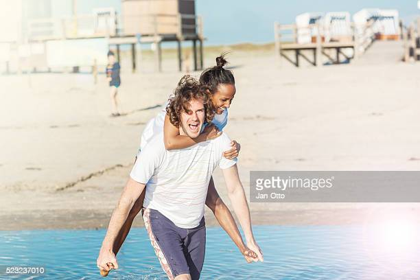 He is carrying her at the beach of St.Peter-Ording,Germany.