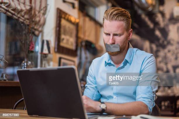 he is feeling trapped in all the work. - modern slavery stock photos and pictures