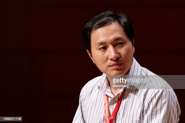 He Jiankui associate professor at the Southern University of Science and Technology of China listens during a panel discussion at the Second...