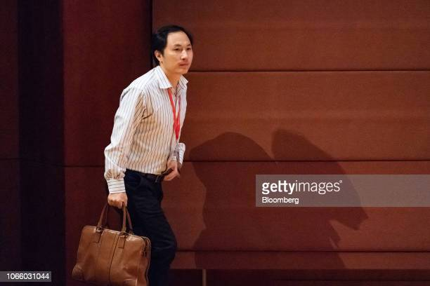 He Jiankui associate professor at the Southern University of Science and Technology of China walks on stage to deliver a speech at the Second...
