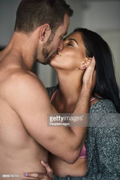 he just can't help himself - interracial wife photos stock photos and pictures