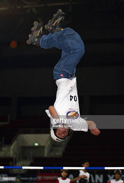 He Kai Zhang of China in action during the JuniorX Aggressive Inline Big Air Final at the Asian XGames finals held at the Bukit Jalil Indoor Stadium...