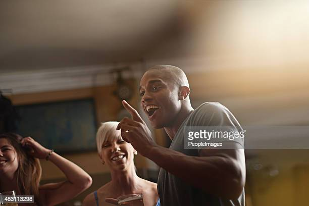 he keeps his friends laughing - clique stock photos and pictures