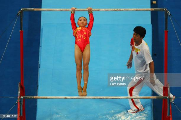 He Kexin of China competes in the women's uneven bars final during the artistic gymnastics at the National Indoor Stadium event on Day 10 of the...