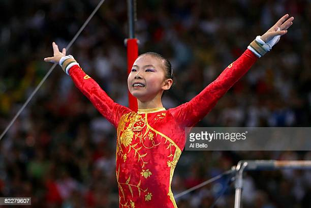 He Kexin of China reacts after competing in the uneven bars during the artistic gymnastics team event at the National Indoor Stadium during Day 5 of...
