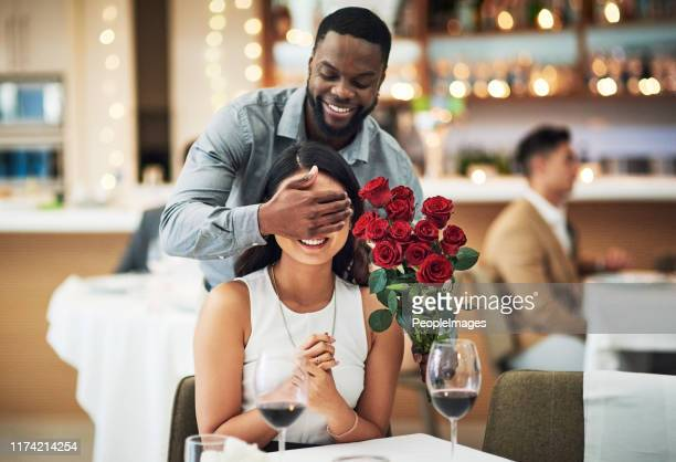 he knows she'll love these - anniversary stock pictures, royalty-free photos & images