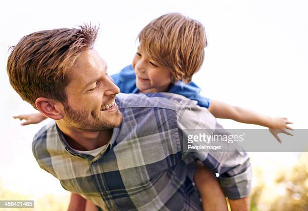 he loves his little boy so much - piggyback stock pictures, royalty-free photos & images
