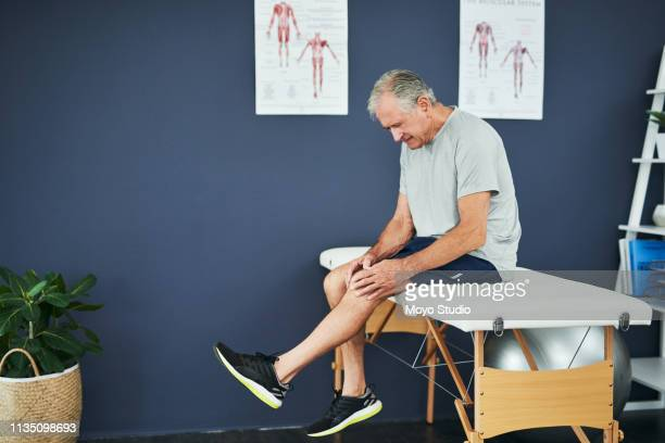 he may have water on his knee... - osteoporosis stock pictures, royalty-free photos & images