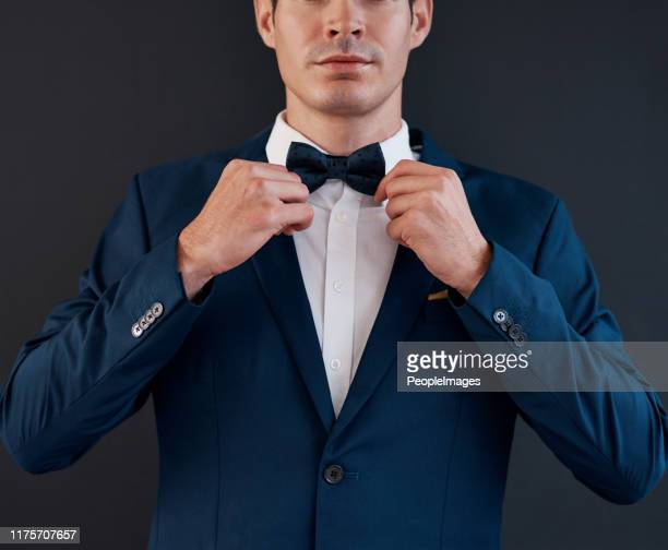 he needs a perfect tie before he says i do - bow tie stock pictures, royalty-free photos & images