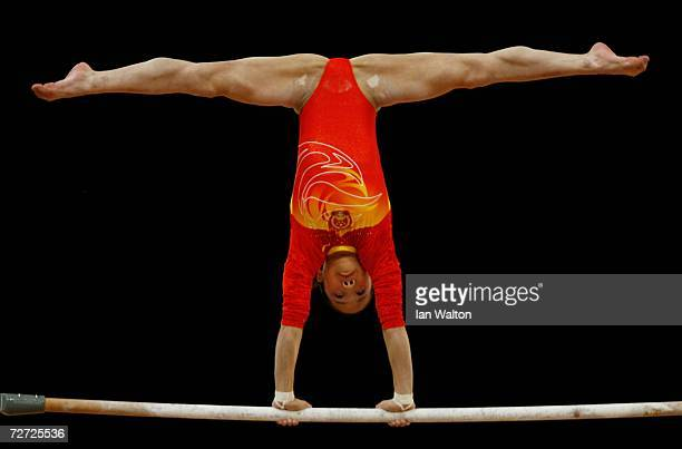 He Ning of China competes in the Women's Uneven Bars final during the Artistic Gymnastics competition during the 15th Asian Games Doha 2006 at The...