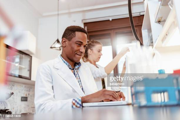 he only uses smart tools in his lab - microbiology stock pictures, royalty-free photos & images