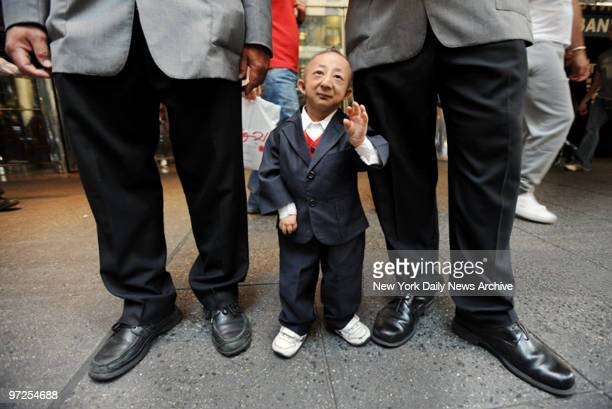 He Pingping the shortest man in the world from China is in New York City seen with doormen from the Grand Hyatt Hotel on E 42st