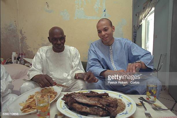 he presidential candidate sits down to dinner with his son Karim