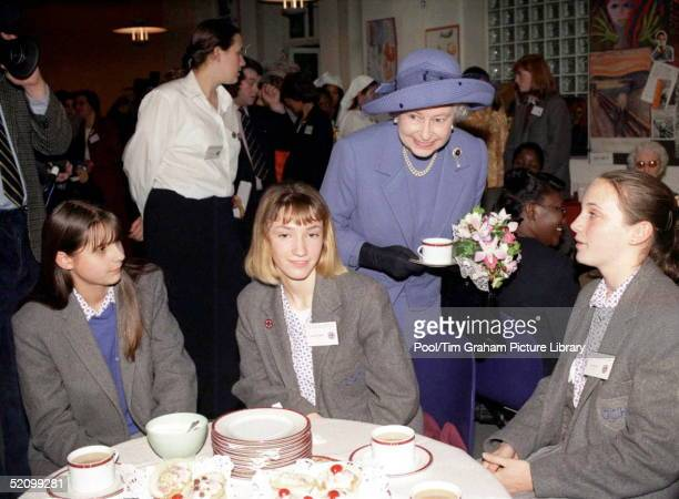 He Queen Enoying A Cup Of Tea During A Visit To The Grey Coat Hospital To Mark Its Tercentenary.