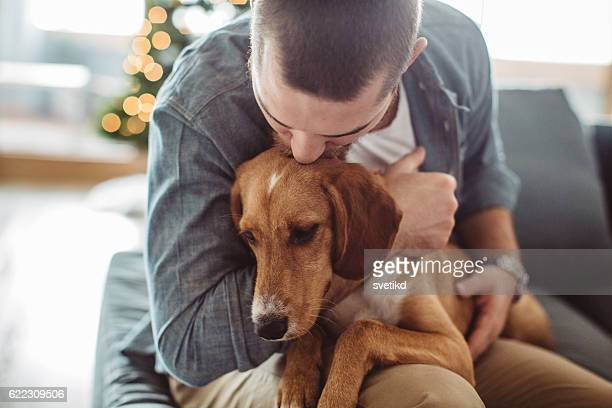 he really is man's best friend - man love stock photos and pictures