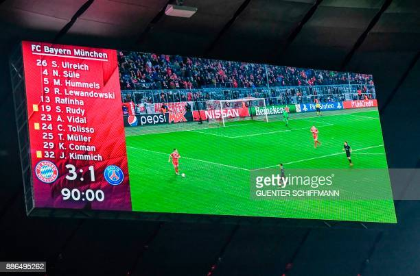 he scoreboard shows the final score 31 after the UEFA Champions League football match between Paris SaintGermain and Bayern Munich on December 5 2017...
