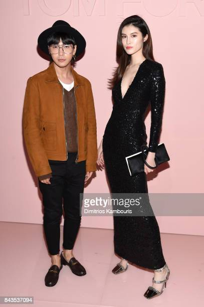 He Sui and guest attend the Tom Ford Spring/Summer 2018 Runway Show at Park Avenue Armory on September 6 2017 in New York City