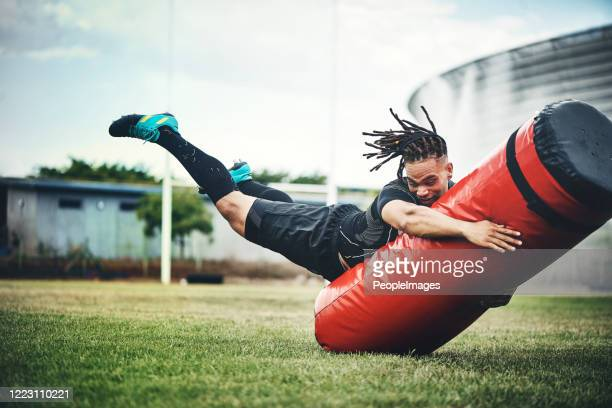 he trains like the rugby pro he is - rugby pitch stock pictures, royalty-free photos & images
