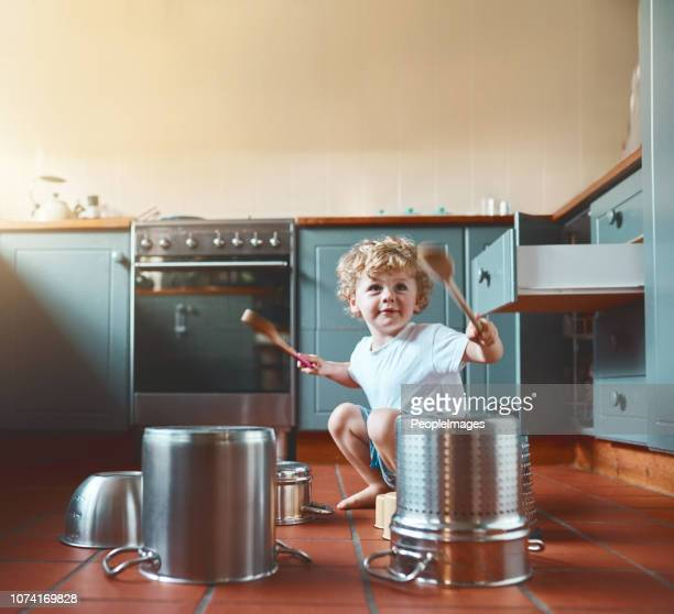 he wants to be a drummer when he grows up - cooking pan stock pictures, royalty-free photos & images