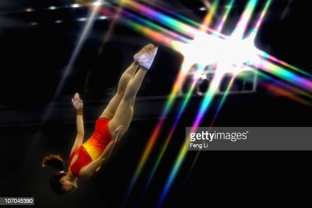 He Wenna of China competes in the Women's Individual Qualification of trampoline gymnastics at Asian Games Town Gymnasium during day nine of the 16th...