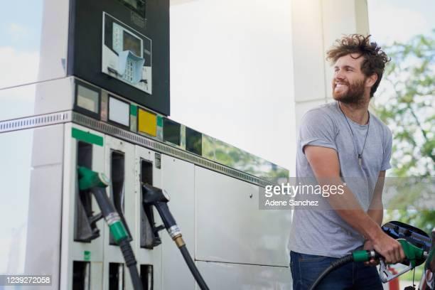 he won't be caught without gas - abastecer imagens e fotografias de stock